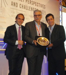 ASUTIL Vice President Marcelo Montico  (Grupo Wisa), on left, and ASUTIL Secretary  General Jose Luis Donagaray, on right, present Essence Corp.'s Jean-Jacques Bona with the 2015 Lifetime Achievement Award