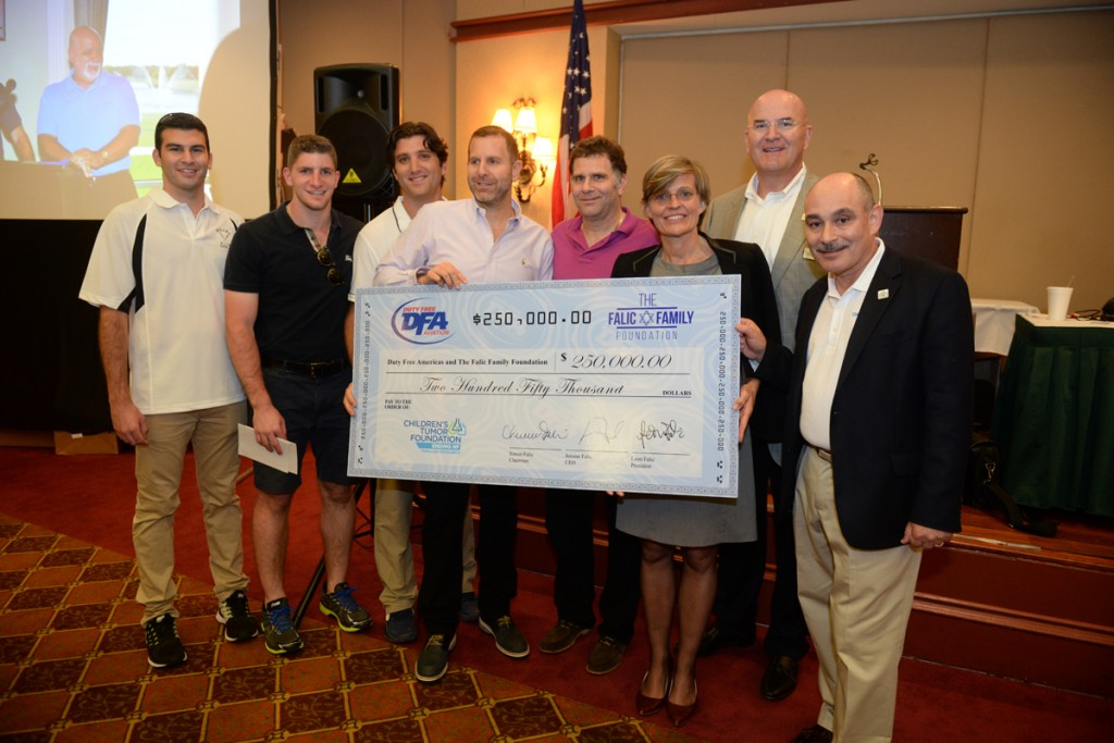 From left:  DFA's Joseph and Dov Falic, Gabe Groisman, Leon and Jerome Falic symbolically hand over a check for $250,000 to Dr. Annette Bakker, William Brooks and Michael A. Divers of the Children's Tumor Foundation at the conclusion of the 2nd DFA charity Golf Tournament on Sept. 10 at the Weston Hills Country Club. Special recognition to Diamond Sponsors Pernod Ricard Travel Retail Americas, Clarins and Moet Hennessy Travel Retail, and Platinum Sponsor Philip Morris Duty Free.