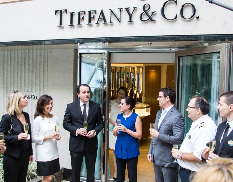 Luciano Rodembusch, VP, Latin America at Tiffany & Co., Beth Neumann, president, Starboard Cruise Services and Mark Tamis, SVP, Hotel Operations, Royal Caribbean International, cut the ribbon to the first Tiffany & Co. boutique at sea.