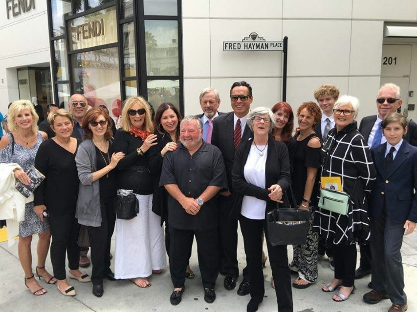 Carol Davy (in white skirt), with Robert Hayman, (in the red tie) and the rest of the former Giorgio Beverly Hills team at the tribute for Fred Hayman on May 15.