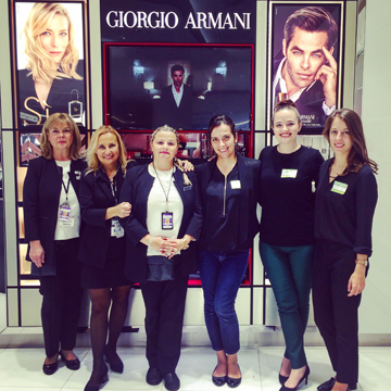 The Giorgio Armani Cosmetics service team (left) with L'Oréal's Marie Dardayrol - Sandevoir, Candice Cooper and Eugenie Ernst (right) at the opening of the GAC counter at Toronto Pearson International Airport earlier this year.