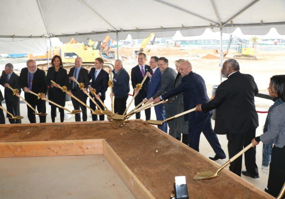 City and airport officials, including Mayor Eric Garcetti, center, marked the groundbreaking of the Midfield Satellite Concourse on February 27.