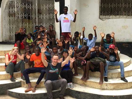 Importations Guay's Justin Guay, Memorial University students and children from Streethearts in Cap Haitian, Haiti.